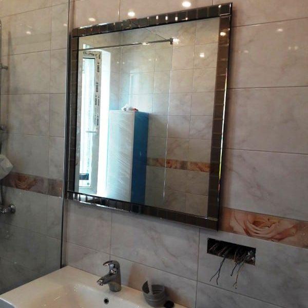 Зеркало с подсветкой в раме из фацетных элементов для ванной комнаты